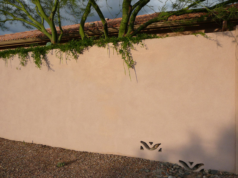 Full late afternoon sunlight shows the wall in a better light.